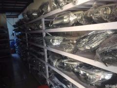 高价回收汽车旧件疝气大灯方向机减震器高价收购