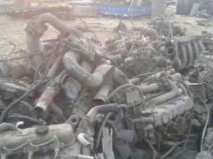 回收豪车的三元催化器、疝气灯、减震器等等零部